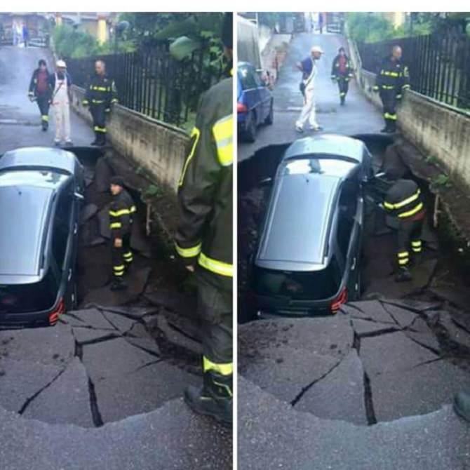 Auto inghiottita da una voragine stradale: donna finisce in ospedale