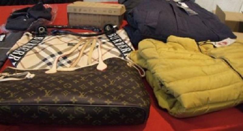 Hogan, Vuitton, Armani…: sequestrati 3500 capi di abbigliamento in due appartamenti