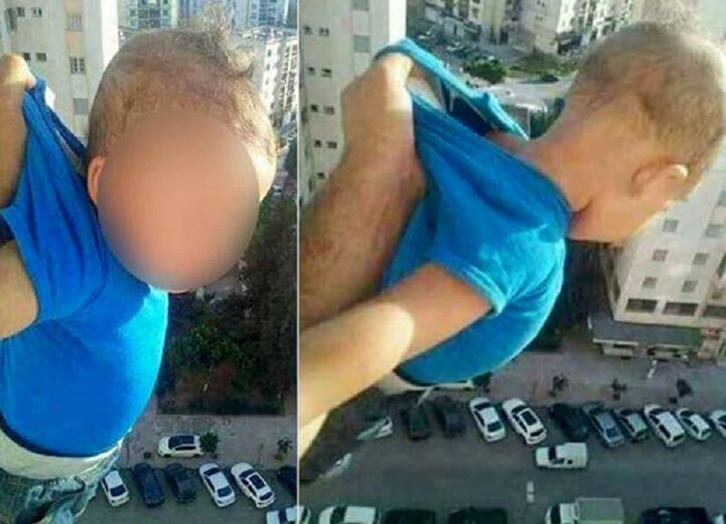 """""""Voglio 1000 'mi piace' altrimenti lo lascio cadere"""": sospende nel vuoto bimbo di 18 mesi, arrestato"""