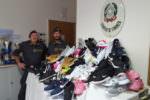 Scarpe contraffatte tra Roma e Catania, un business da oltre due milioni di euro: maxi sequestro della Guardia di Finanza
